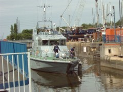 HMS Charger makes its way through into the Dock