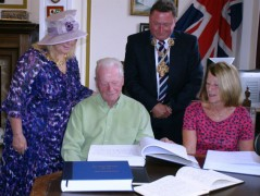 The Finney family presented with the books of condolence by the city council