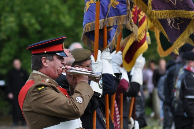 Sergeant major Gerry Copland plays the 'Last Post' on the bugle