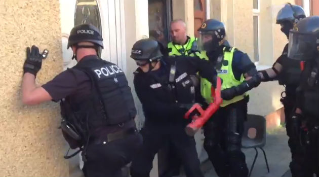 Police raid a home in Preston