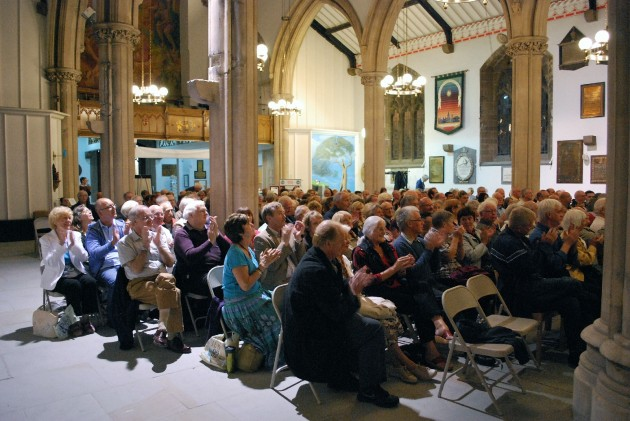 The audience of members and guests show their appreciation to Stephen Sartin for a wonderful evenings entertainment
