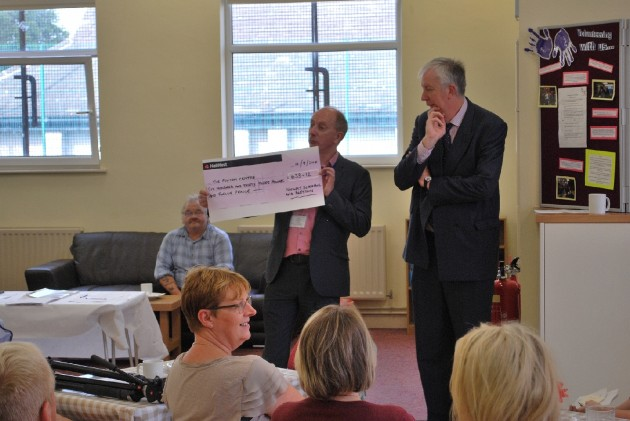 To the right, Foxton Centre Chair, Ray Thomas congratulates all involved with refurbishing and helping out with the set-up of the facilities. To the left, centre manager, Tim Keightley displays a cheque for £633.12 donated by the   staff of Natwest Bank from a sponsored event