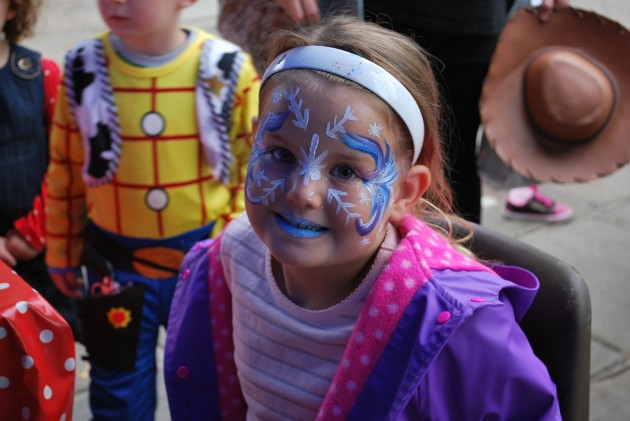 Four and a half year old Jessica Brown samples the face painting