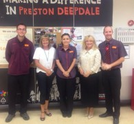 Headway staff with Sainsbury's workers at the Deepdale store