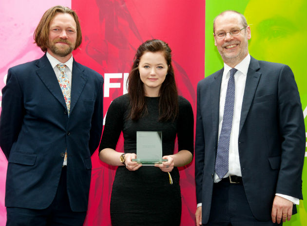 Catherine Shaw picks up a prize from UCLan from sculptor Charles Hadcock and Gerry Kelleher