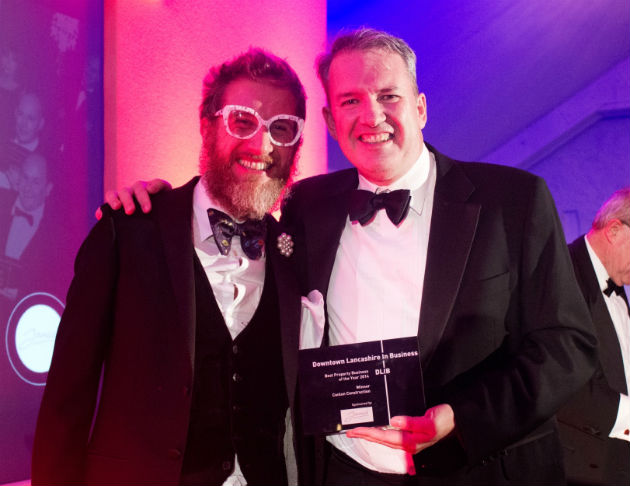 Michael Conlon (right) picks up his award from Andrew Leeming of Lancashire County Council