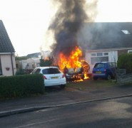 The car blazing away on the drive