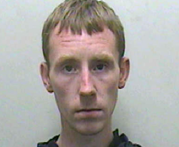 Carl Barton is wanted by police in connection with the stabbing
