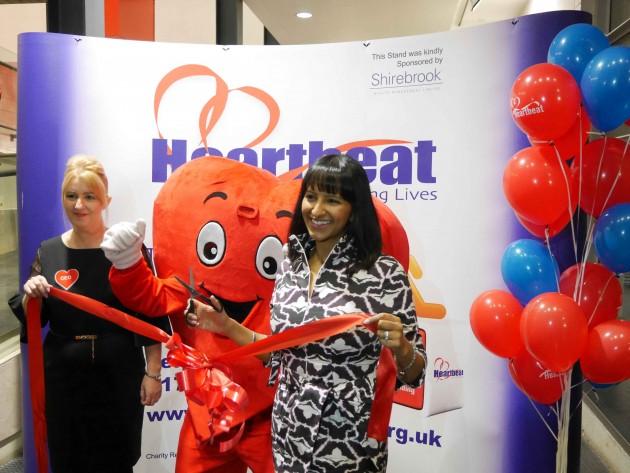Jill Rogerson and Ranvir Singh alonside mascot Cardiac Carl