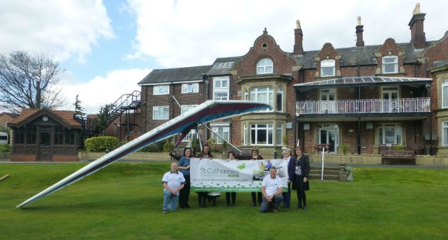 The microlight with hospice staff and volunteers