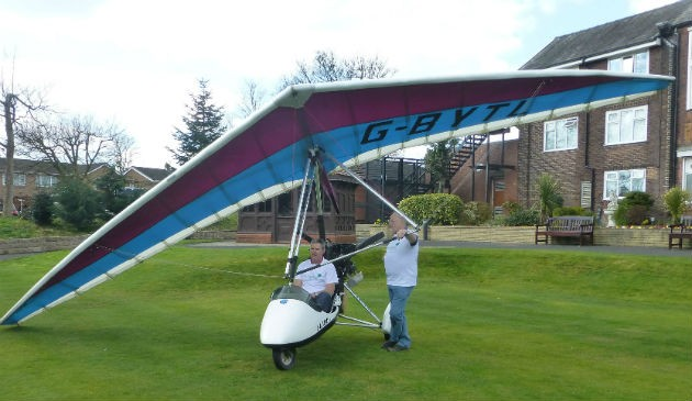 Tim and Neil brought their microlight into the hospice grounds