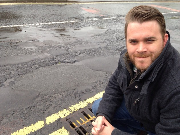 Councillor John Potter by the road surface on Black Bull Lane