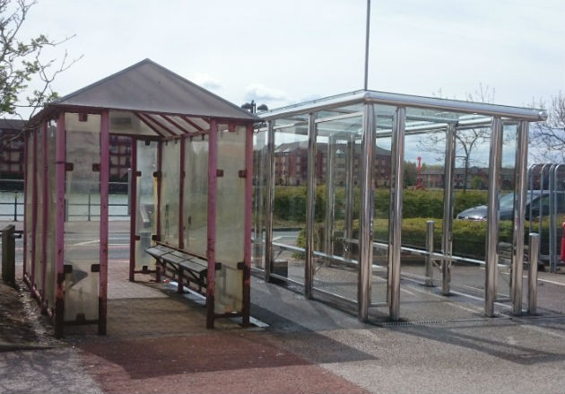 The new and old bus shelters side by side