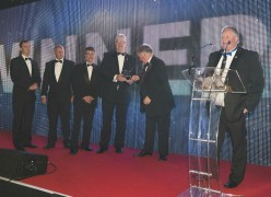 Stephen R Pearson of Our Local Heroes Foundation collects the award with his colleagues