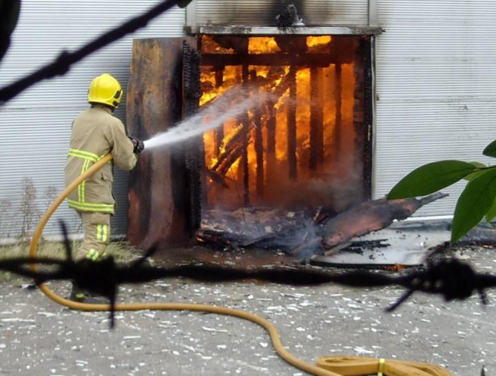 A fire fighter battles the skate park flames