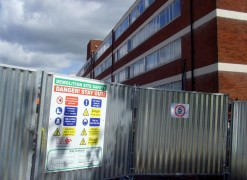Signs have gone up along with fencing around the Fylde building Pic: Tony Worrall