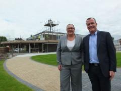 The new showroom building taking shape behind Bowker Motorrad head of business Geraldine Bowers-Lyon with Bowker BMW managing director, Tom Fox