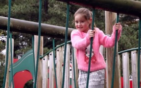 A little girl features in the video
