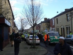 The parade makes its way past the murder scene in Fishwick