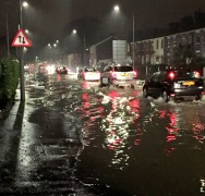 Traffic passing through standing water in Victoria Road on Boxing Day evening Pic: Louise Hogg
