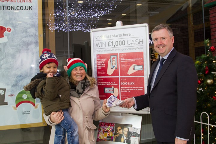 Ann receiving her prize from shopping centre manager Andrew Stringer