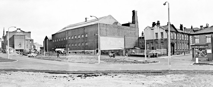 Southeast view of former Slinger's Army Stores on the corner of Lancaster Road and Walker Street