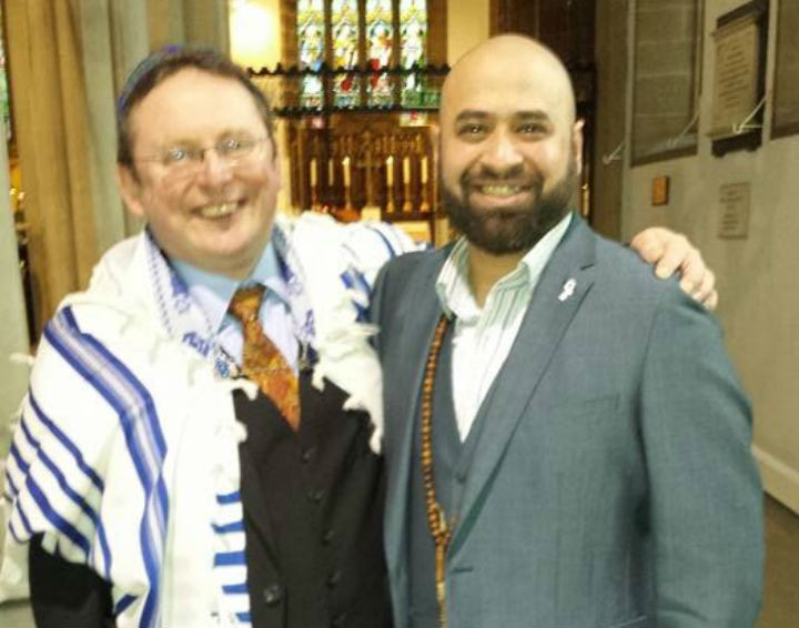 Ali Amla, right, at the Holocaust Memorial Day service