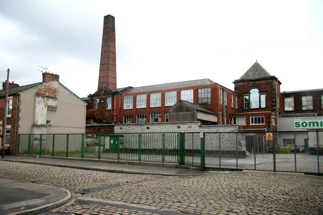Former Alliance Works Mill next to Centenary Mill and facing on to Stefano Road. This was a weaving mill with large sheds to the rear. © Copyright Chris Allen and licensed for reuse under Creative Commons Licence