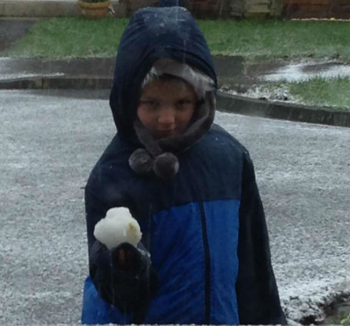 This little lad wasted no time in getting his first snowball together in Penwortham Pic: Jen Williams