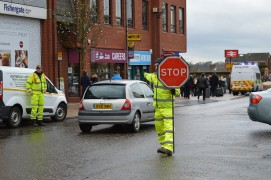 The temporary human traffic light in action before Christmas Pic: Tony Worrall