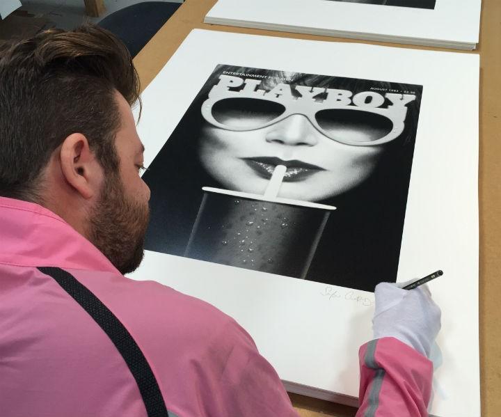 Simon Claridge signing one of his prints