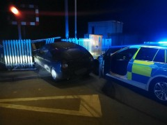The car hit the fence near the level crossing Pic: Lancashire Road Police