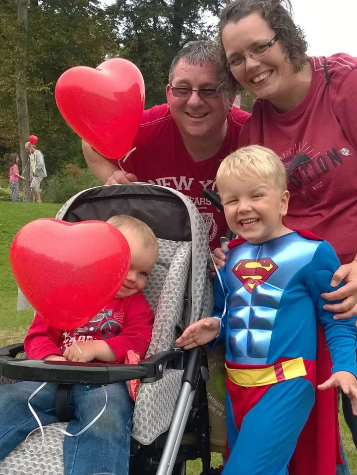 Kelly with her husband Paul, and sons Oliver (superman costume) and Harrison doing the Heartbeat walk to raise £200 for charity.
