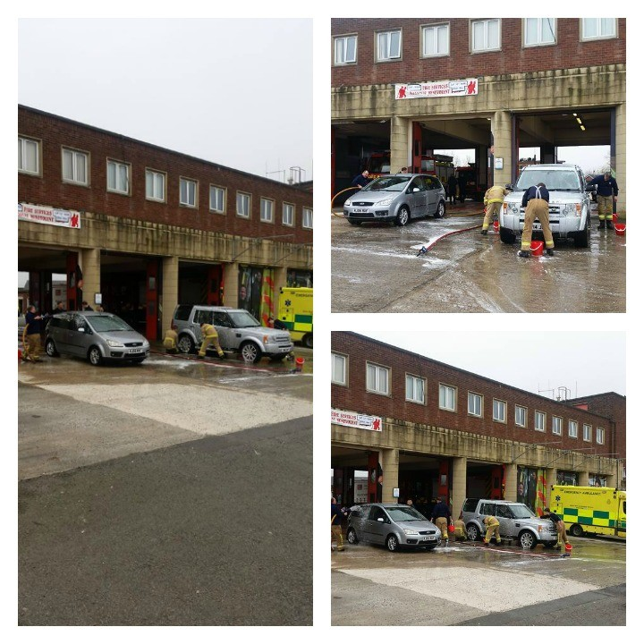 Firefighters washing cars at Preston Fire Station on Saturday