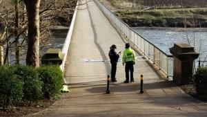 Police officers at the Old Tram Bridge Pic: Siad Ugradar
