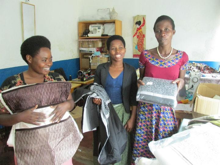 Agnes, Olive and Amina with the donated fabrics