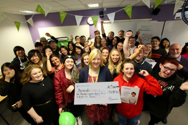 Barnardo's fundraising manager, centre, with students at UCLan