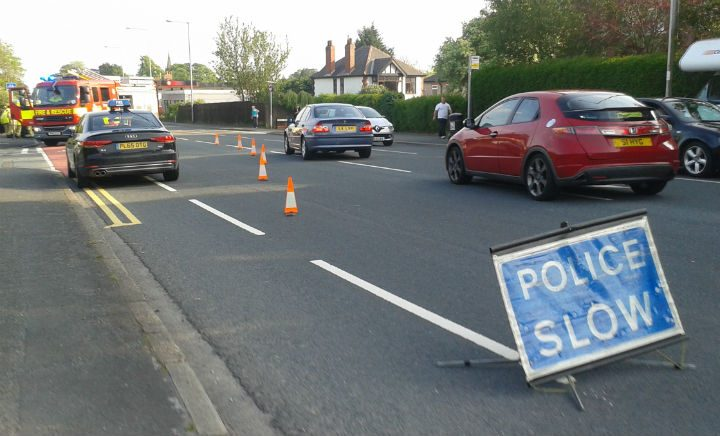 A police sign sees drivers go round the scene of the collision