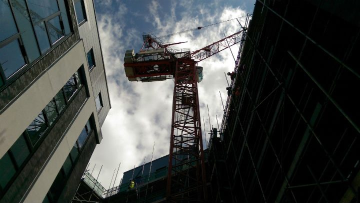 Looking up at the giant crane in the centre of the development scheme