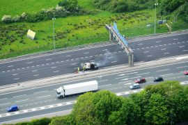 Fire crews working on the wreckage of the van Pic: NPAS Warton