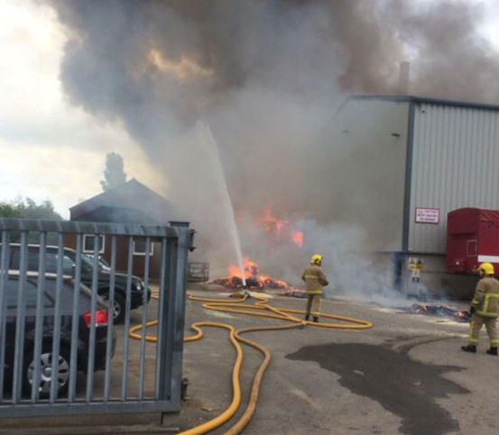 Crews at work within the industrial complex off Church Lane