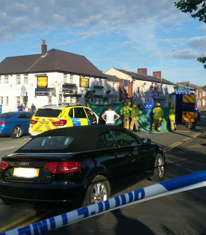 Emergency services erect a curtain around the crash scene Pic: Peter Charles