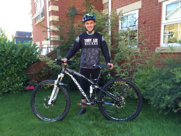 Duke of Edinburgh Gold Award winner, Cameron Roche with his mountain bike