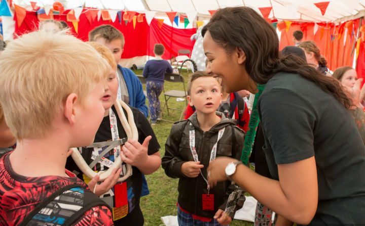 Elizabeth meets some very impressed young men (look at the kid in the middle!) Pic: Dan Collins