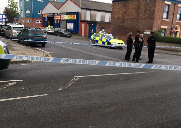 Police tape across the road