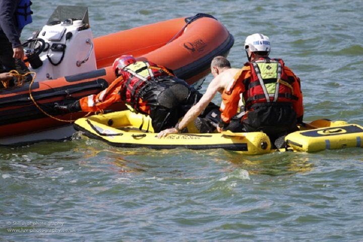 The man is helped onto a larger boat Brian Sandham of Stillshot photography