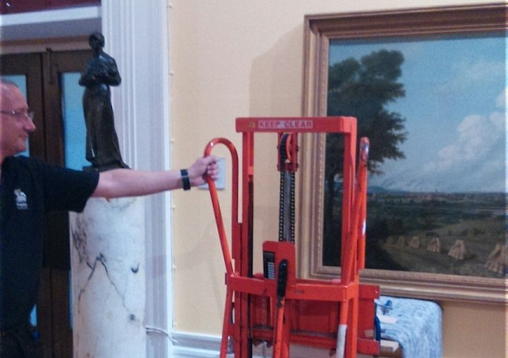 The painting being put into position