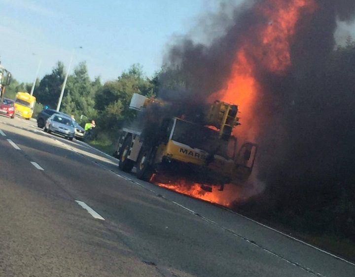 The severity of the fire means the road is likely to be shut for a number of hours Pic: Peter Charles