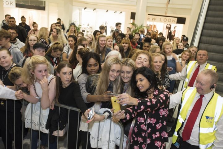 cara-takes-a-selfie-with-the-crowd