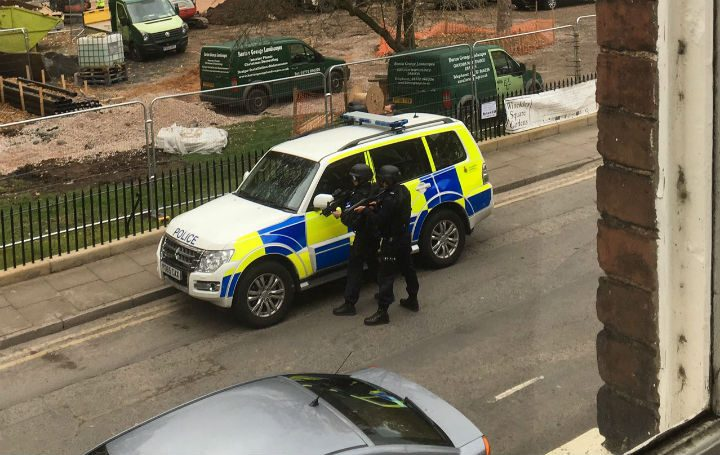 A police vehicle with armed officers